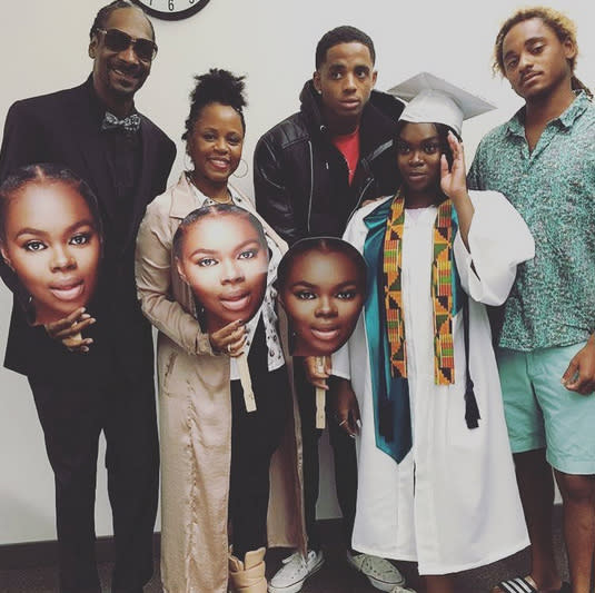 """<p>""""Broadus family baby girl completes the trifecta,"""" proud dad Snoop Dogg captioned this picture of his family (including wife Shante Broadus, and sons Cordell and Corde Broadus) celebrating 17-year-old daughter Cori's high school graduation on June 8. We love that Snoop was one of those dads sporting a giant cutout of his daughter's face. Being a proud parent is always in, whether you are famous or not. (Photo: <a href=""""https://www.instagram.com/p/BVHFYhojrK7/?taken-by=snoopdogg&hl=en"""" rel=""""nofollow noopener"""" target=""""_blank"""" data-ylk=""""slk:Snoop Dogg via Instagram"""" class=""""link rapid-noclick-resp"""">Snoop Dogg via Instagram</a>) </p>"""