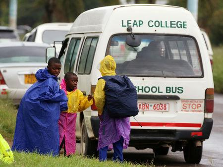 Zimbabwean schoolchildren await transport from school during a teachers' strike in Harare, Zimbabwe, February 8, 2019. REUTERS/Philimon Bulawayo