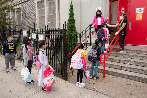 PHOTO: Students line up to have their temperature checked before entering PS 179 elementary school in Brooklyn, New York, Sept. 29, 2020. (Mark Lennihan/AP)
