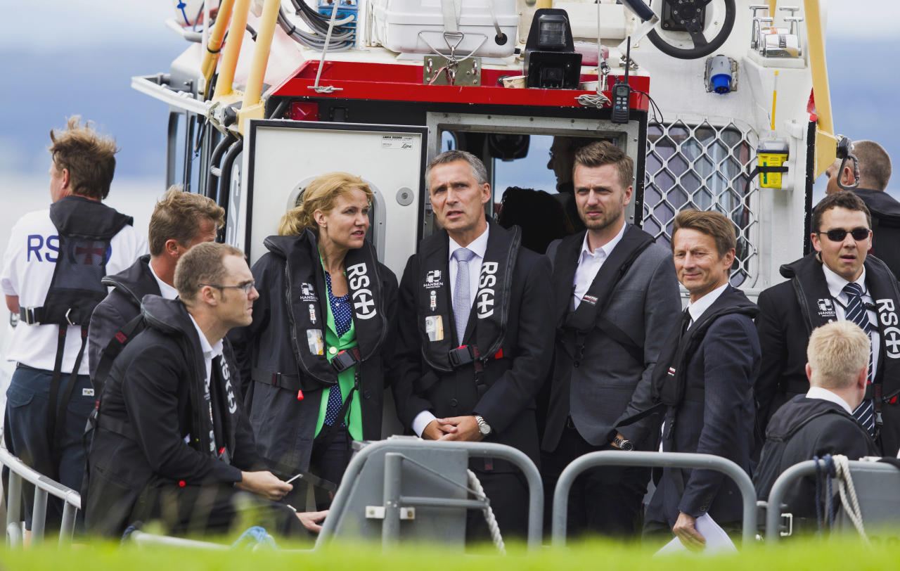 Danish Prime Minister Helle Thorning-Schmidt, third left, and her Norwegian counterpart Jens Stoltenberg, center, are ferried across to Utoya Island, Norway Sunday July 22, 2012 to mark the first anniversary of the bomb and shooting tragedy in Oslo and on the Utoya Island. Norway on Sunday paused to commemorate the 77 victims of a bomb and gun massacre that shocked the peaceful nation one year ago, a tragedy that the prime minister said had brought Norwegians together in defense of democracy and tolerance. (AP Photo/Vegard Groett / NTB scanpix)