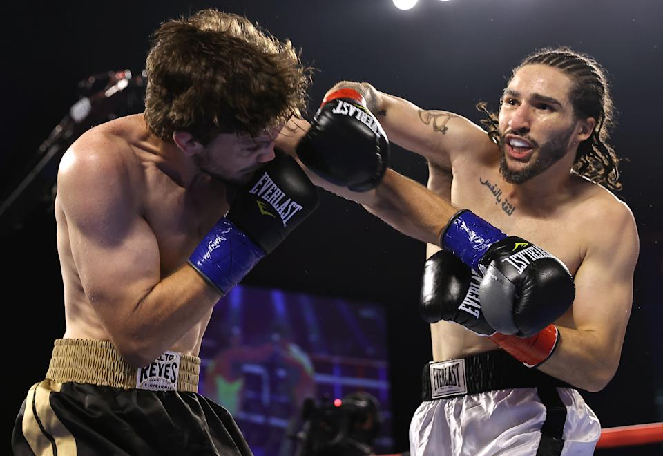 CATOOSA, OKLAHOMA - AUGUST 14: Jordan Weeks (L) and Nico Ali Walsh (R) exchange punches during their fight at Hard Rock Hotel & Casino Tulsa on August 14, 2021 in Catoosa, Oklahoma. (Photo by Mikey Williams/Top Rank Inc via Getty Images)