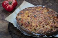 """<p>This Southern-inspired tomato pie is a great way to use the fresh tomatoes in your garden before the season ends. If you don't feel like <a href=""""https://www.thedailymeal.com/best-recipes/easy-pie-crust?referrer=yahoo&category=beauty_food&include_utm=1&utm_medium=referral&utm_source=yahoo&utm_campaign=feed"""" rel=""""nofollow noopener"""" target=""""_blank"""" data-ylk=""""slk:making your own crust"""" class=""""link rapid-noclick-resp"""">making your own crust</a>, you can use <a href=""""https://www.thedailymeal.com/cook/7-recipes-aren-t-pie-using-refrigerated-pie-crust?referrer=yahoo&category=beauty_food&include_utm=1&utm_medium=referral&utm_source=yahoo&utm_campaign=feed"""" rel=""""nofollow noopener"""" target=""""_blank"""" data-ylk=""""slk:refrigerated pie crust"""" class=""""link rapid-noclick-resp"""">refrigerated pie crust</a> instead.</p> <p><a href=""""https://www.thedailymeal.com/recipes/tomato-pie-pimento-cheese?referrer=yahoo&category=beauty_food&include_utm=1&utm_medium=referral&utm_source=yahoo&utm_campaign=feed"""" rel=""""nofollow noopener"""" target=""""_blank"""" data-ylk=""""slk:For the Tomato Pie With Pimento Cheese Topping recipe, click here."""" class=""""link rapid-noclick-resp"""">For the Tomato Pie With Pimento Cheese Topping recipe, click here.</a></p>"""