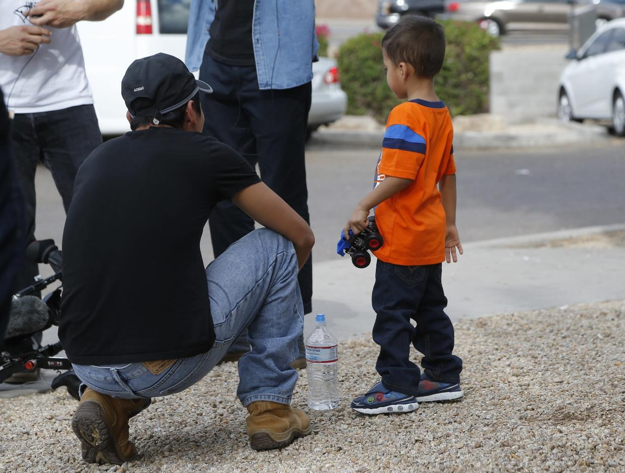 "<span class=""s1"">Jose and his 3-year-old son, Jose Jr., after they were reunited on July 10 in Phoenix. (Photo: Ross D. Franklin/AP)</span>"