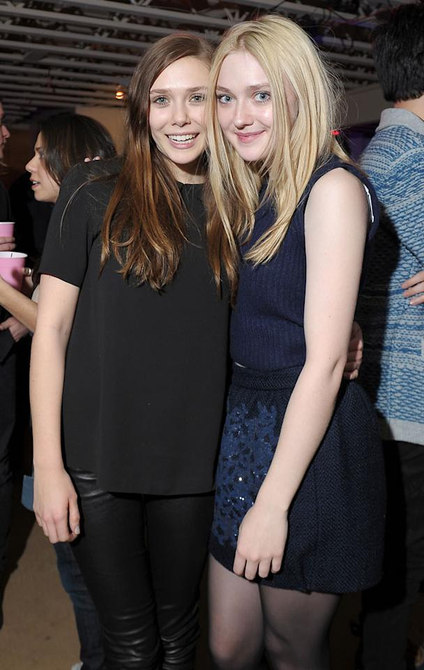 PARK CITY, UT - JANUARY 22: Actresses Elizabeth Olsen (L) and Dakota Fanning attend The Mint Agency, The Branding Be, and Simple Night host the after party for 'Very Good Girls' At Nur Khan Presents on January 22, 2013 in Park City, Utah. (Photo by Michael Loccisano/Getty Images)