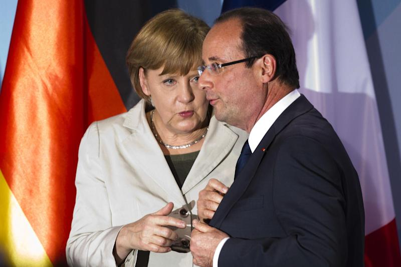 FILE - In this May 15, 2012 file photo, German Chancellor Angela Merkel, left, talks to new French President Francois Hollande in Berlin. President Barack Obama will play host this weekend to an extraordinary confluence of international summitry, with world leaders scuttling from the Maryland mountains to downtown Chicago as they grapple for fixes to Europe's mounting economic woes and solidify plans for winding down the decade-long war in Afghanistan. (AP Photo/Markus Schreiber, File)