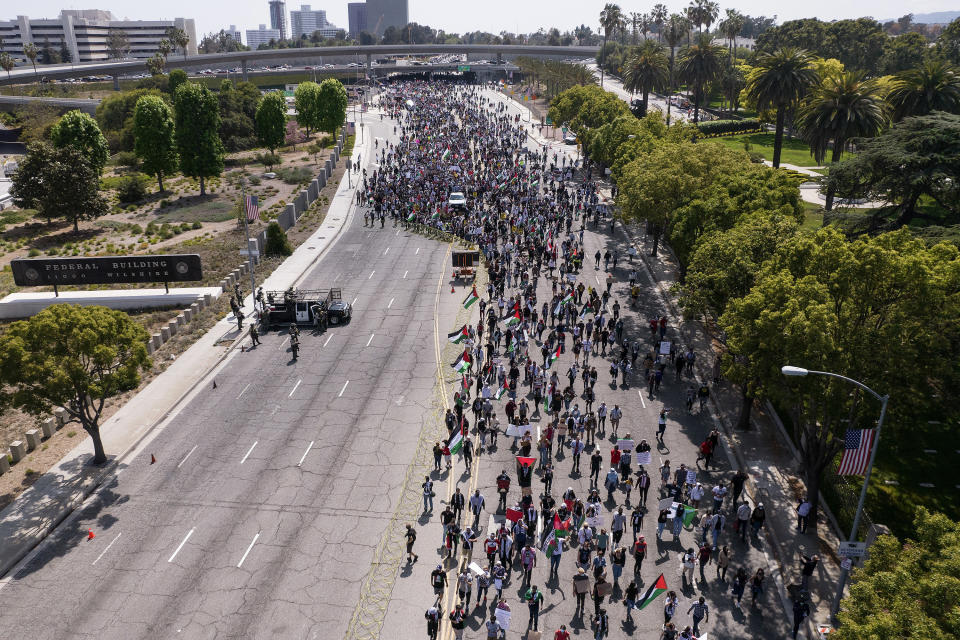 In this photo taken by a drone, thousands of demonstrators protest outside the Federal Building against Israel and in support of Palestinians during the current conflict in the Middle East, Saturday, May 15, 2021, in the Westwood section of Los Angeles. (AP Photo/Ringo H.W. Chiu)