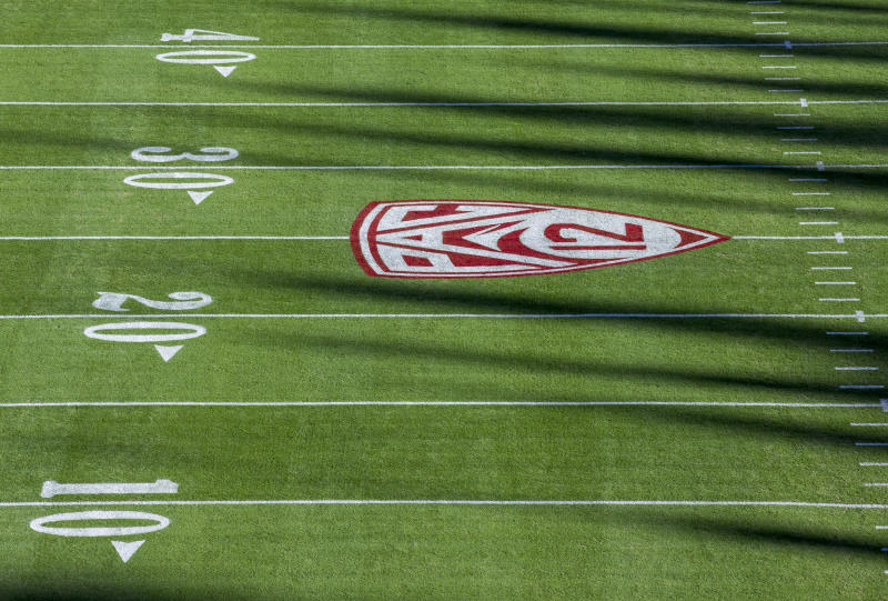 The shadows over college football are growing longer. (Photo by David Madison/Getty Images)