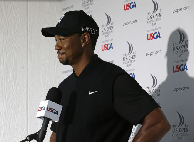 FILE - In this June 18, 2015, file photo, Tiger Woods speaks to the media during a news conference after shooting a 10 over-par 80 in the first round of the U.S. Open golf tournament at Chambers Bay in University Place, Wash. Woods has filed his entry to play in the U.S. Open for the first time since 2015. The USGA says Woods officially entered on Thursday, April 12, 2018, four days after he tied for 32nd in the Masters.(AP Photo/Ted S. Warren)