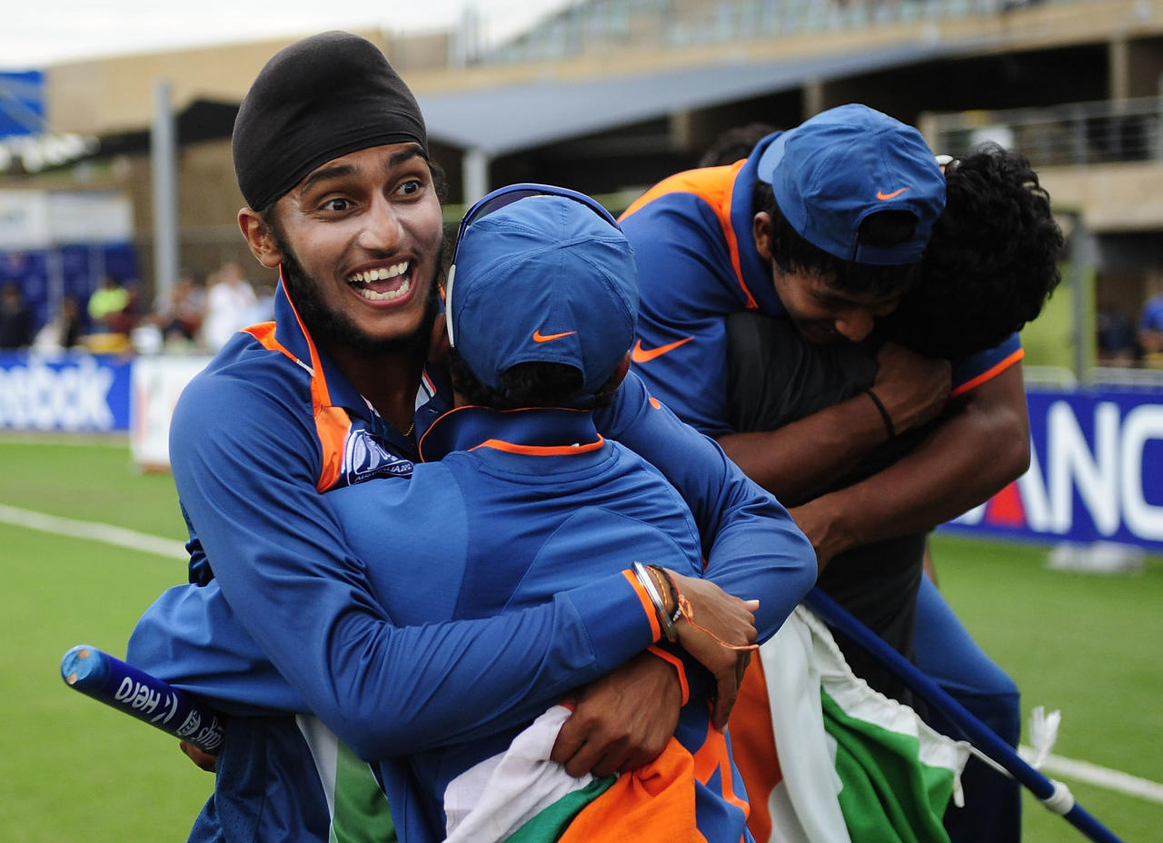 TOWNSVILLE, AUSTRALIA - AUGUST 26:  Harmeet Singh (L) of India celebrates with team mates after winning  the 2012 ICC U19 Cricket World Cup Final between Australia and India at Tony Ireland Stadium on August 26, 2012 in Townsville, Australia.  (Photo by Ian Hitchcock-ICC/Getty Images)