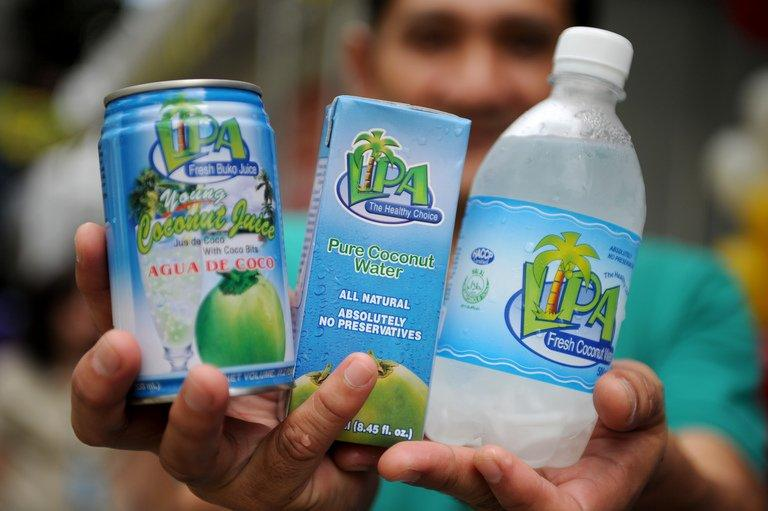 This photo taken on August 30, 2012 shows a vendor displaying coconut-water products in Manila