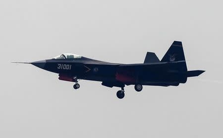 A J-31 stealth fighter of Chinese People's Liberation Army Air Force is seen during a test flight ahead of the 10th China International Aviation and Aerospace Exhibition in Zhuhai, Guangdong province, November 10, 2014. REUTERS/Alex Lee