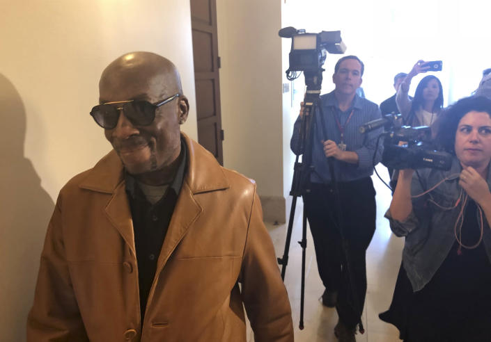 FILE - In this Oct. 10, 2018 file photo, plaintiff DeWayne Johnson, a school groundskeeper who says Roundup weed-killer caused his cancer, leaves a courtroom in San Francisco. A Northern California groundskeeper says he will accept a judge's reduced verdict of $78 million against Monsanto after a jury found the company's weed killer caused his cancer. DeWayne Johnson's attorney informed the San Francisco Superior Court on Wednesday, Oct. 31, 2018. (AP Photo/Paul Elias, File)