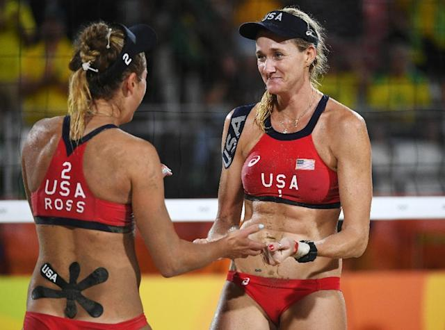 USA's Kerri Walsh Jennings (R) celebrates with teammate April Ross after winning their beach volleyball bronze medal match against Brazil, at the Rio 2016 Olympic Games, on August 17 (AFP Photo/Yasuyoshi Chiba)