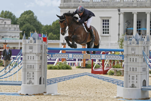 Britain's Peter Charles rides Vindicat during the equestrian individual jumping third qualifier in Greenwich Park at the London 2012 Olympic Games August 6, 2012. REUTERS/Mike Hutchings (BRITAIN - Tags: SPORT EQUESTRIANISM OLYMPICS)