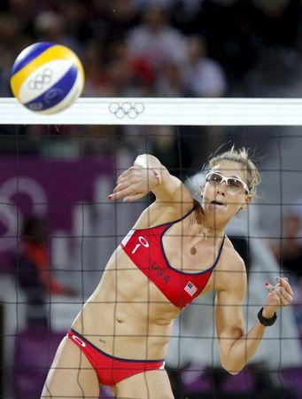Kerri Walsh Jennings of the U.S. spikes the ball at the women's beach volleyball gold medal match at the Horse Guards Parade during the London 2012 Olympic Games in this August 8, 2012 file photo. Few women have competed in the Olympics while pregnant, but the suspicion that the Zika virus in mothers is causing birth defects is central to calculations by athletes and others planning travel to Brazil in August for the summer games. Eighteen women have competed in modern Olympics while pregnant according to a group of Olympic historians who publish their statistics at Sports-Reference.com. The number includes U.S. beach volleyball gold medalist Kerri Walsh, who was not yet aware she was pregnant when competing in London in 2012.    REUTERS/Dominic Ebenbichler