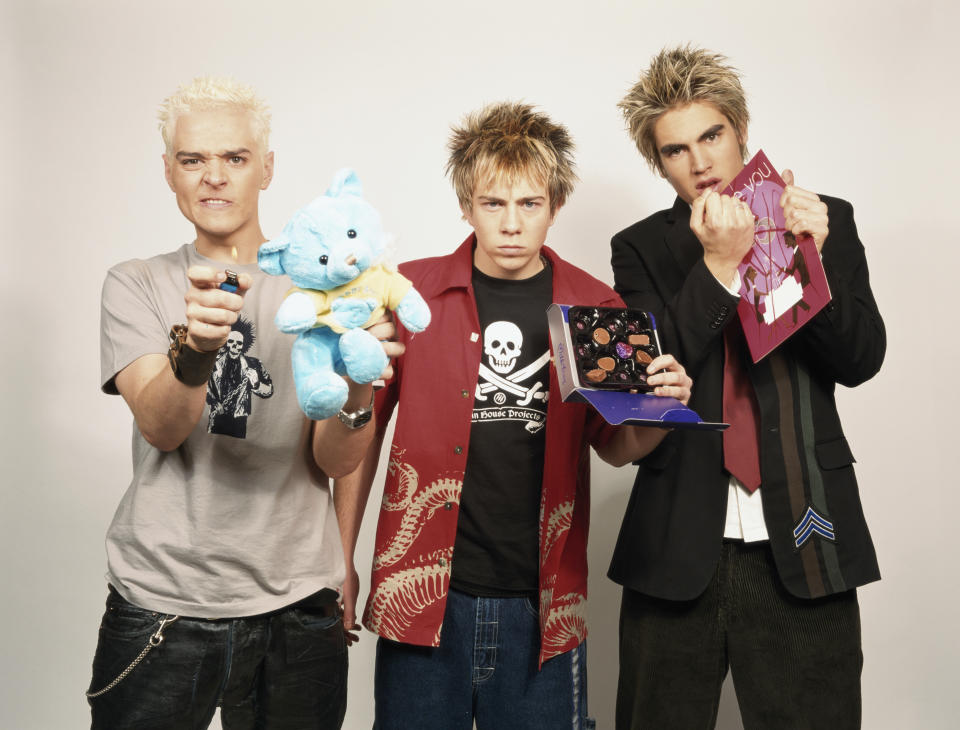 British pop group Busted, circa 2003. Left to right: Matt Willis, James Bourne and Charlie Simpson. (Photo by Tim Roney/Getty Images)