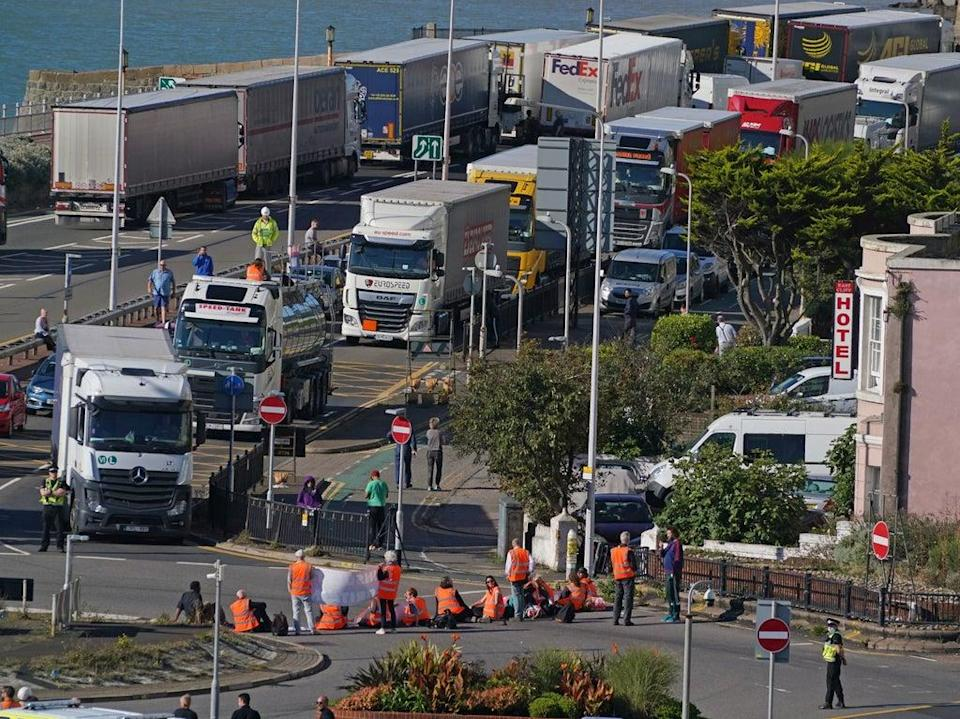 Protesters from Insulate Britain block the A20 in Kent, which provides access to the Port of Dover in Kent (Gareth Fuller/PA)