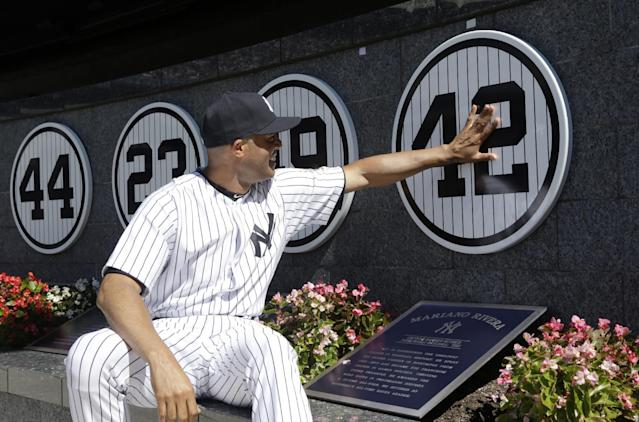 New York Yankees relief pitcher Mariano Rivera touches his plaque in Monument Park as he is honored in a pregame ceremony at Yankees Stadium before the Yankees baseball game against the San Francisco Giants, Sunday, Sept. 22, 2013, in New York. The 13-time All-Star closer is retiring at the end of this season. (AP Photo/Kathy Willens, Pool)