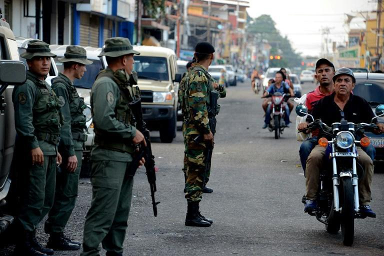 Military checkpoints, such as this one in Tachira pictured in 2016, are commonplace in Venezuela, and regular taxi drivers say soldiers moonlighting as drivers can pass through them more easily