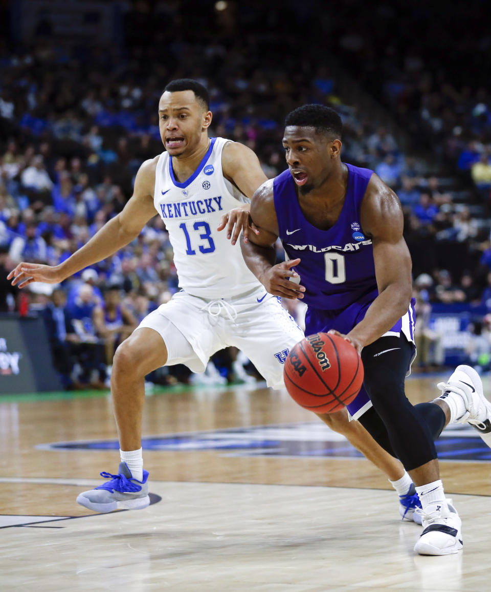 Abilene Christian's Jaylen Franklin (0) drives to the basket Kentucky's Jemarl Baker Jr. (13) during the first half of a first-round game in the NCAA mens college basketball tournament in Jacksonville, Fla., Thursday, March 21, 2019. (AP Photo/Stephen B. Morton)