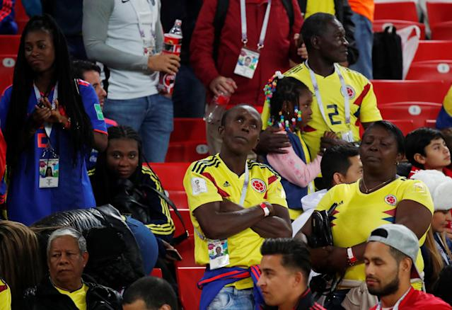 <p>Colombia fans look dejected after the match. REUTERS/Maxim Shemetov </p>