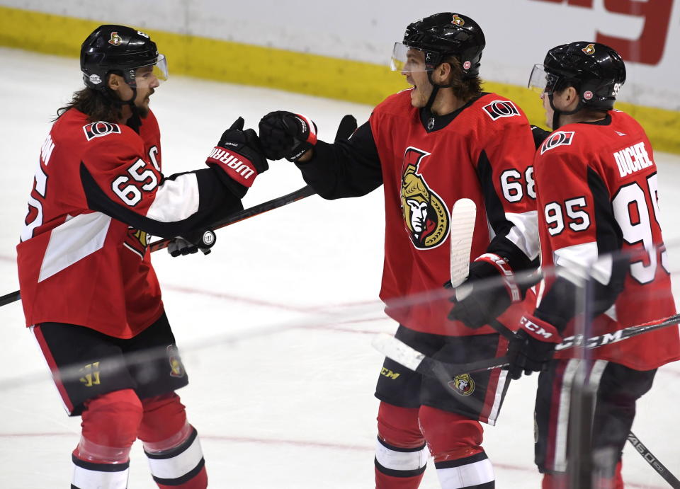 The fiancee of Ottawa Senators' Mike Hoffman (68) is accused of harassing the wife of Erik Karlsson (center). (Justin Tang/The Canadian Press via AP)