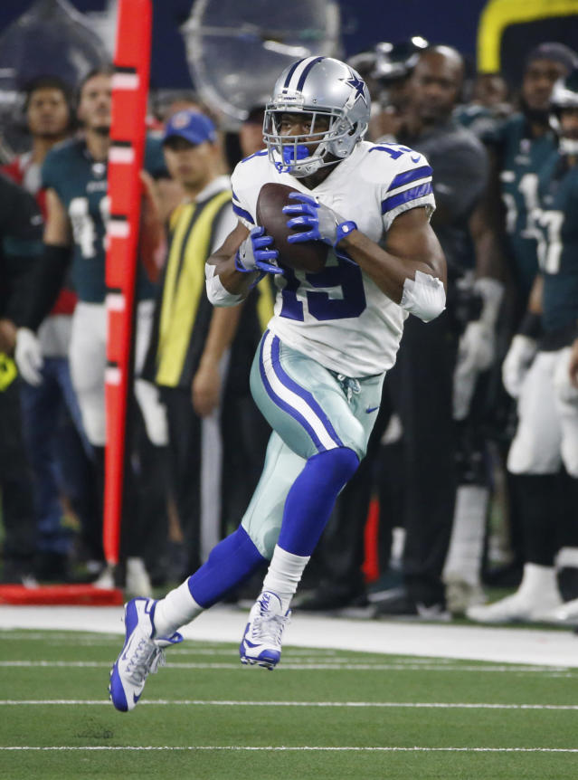 Dallas Cowboys wide receiver Amari Cooper (19) catches a long pass in the first half of an NFL football game against the Philadelphia Eagles in Arlington, Texas, Sunday, Oct. 20, 2019. (AP Photo/Ron Jenkins)