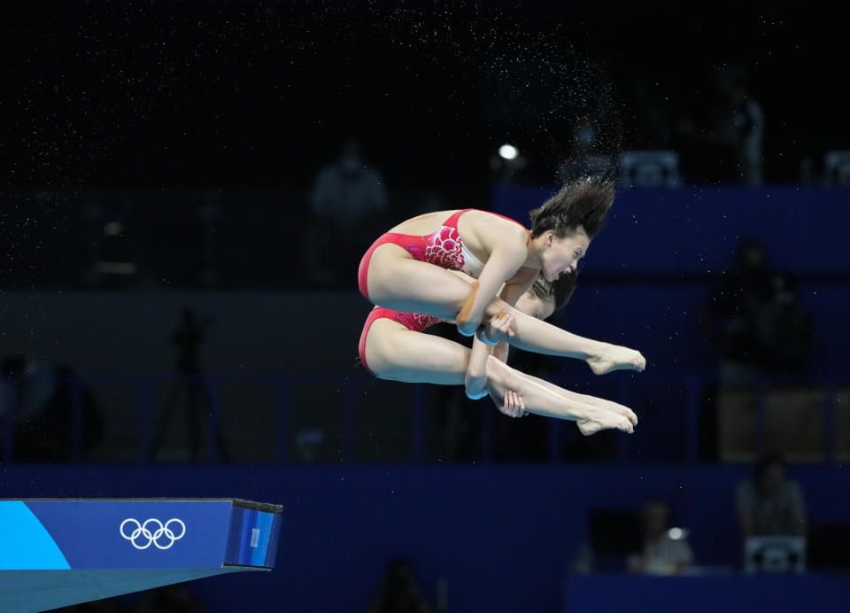 Yuxi Chen and Jiaqi Zhang of China compete during the women's synchronized 10m platform diving final at the Tokyo Aquatics Centre at the 2020 Summer Olympics, Tuesday, July 27, 2021, in Tokyo, Japan. (AP Photo/Dmitri Lovetsky)