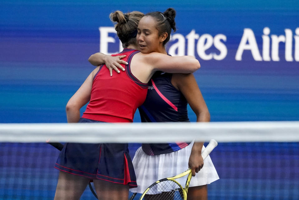 Leylah Fernandez, of Canada, right, hugs Elina Svitolina, of Ukraine, after defeating Svitolina in the quarterfinals of the US Open tennis championships, Tuesday, Sept. 7, 2021, in New York. (AP Photo/Elise Amendola)