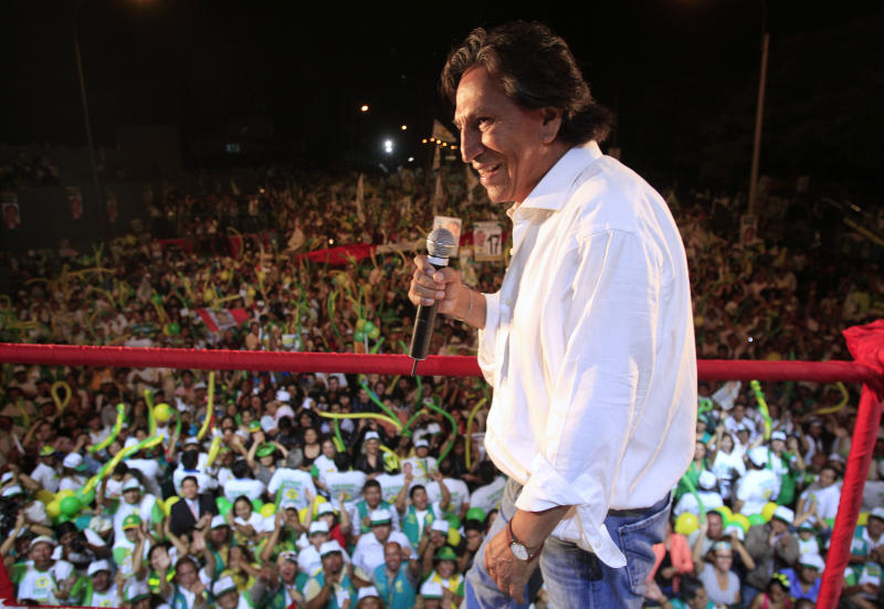 File - In this April 7, 2011, file photo, Presidential candidate Alejandro Toledo, of the political party Peru Possible, delivers a speech during a campaign rally in Lima, Peru. Authorities say a former Peruvian president who is wanted in connection with Latin America's biggest graft scandal was arrested in California on suspicion of public intoxication over the weekend and was briefly detained. San Mateo County Sheriff's Office spokeswoman Rosemerry Blankswade said Monday, March 18, 2019, that Toledo was arrested Sunday night near a restaurant near the San Francisco Bay city of Menlo Park. (AP Photo/Martin Mejia, File)