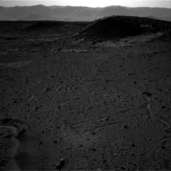 A bright flash of light appears to be visible in the distance in this image taken by the right-side navigation camera on NASA's Mars rover Curiosity on April 3, 2014.