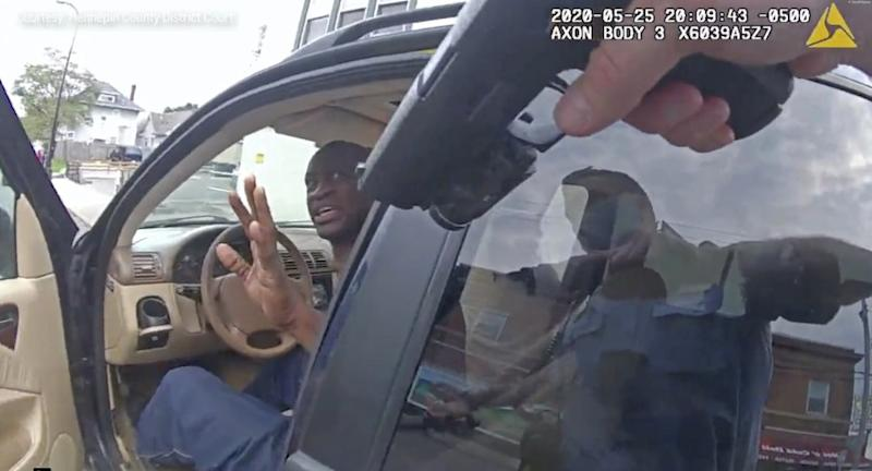 Minneapolis Police Officer Thomas Lane points his gun at George Floyd in body cam video just ordered released by the Hennepin County District Court.
