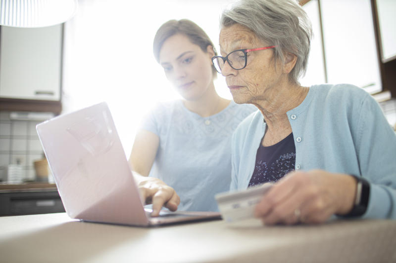 RADEVORMWALD, GERMANY - MAY 12: In this photo illustration two women are looking at a laptop doing online shopping on May 12, 2020 in Radevormwald, Germany. (Photo by Ute Grabowsky/Photothek via Getty Images)