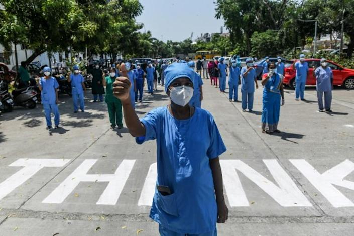 India announced a fresh record in the number of confirmed COVID-19 infections on Saturday (AFP Photo/Arun SANKAR )