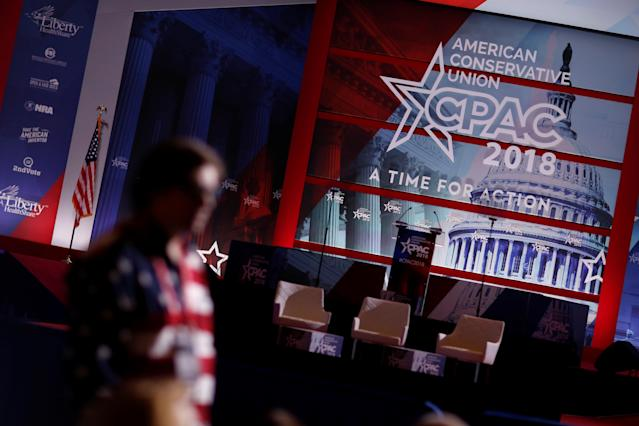 <p>People wait for the start of the second day of the Conservative Political Action Conference (CPAC) at National Harbor, Md., Feb. 23, 2018. (Photo: Kevin Lamarque/Reuters) </p>
