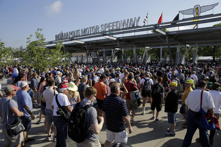 """FILE - Fans make their way through the main gate and security as they arrive before the 100th running of the Indianapolis 500 auto race at Indianapolis Motor Speedway in Indianapolis, in this Sunday, May 29, 2016, file photo. The Indianapolis 500 will be the largest sporting event since the start of the pandemic with 135,000 spectators permitted to attend """"The Greatest Spectacle in Racing"""" next month. Indianapolis Motor Speedway said Wednesday, April 21, 2021, it worked with the Marion County Public Health Department to determine 40% of venue capacity can attend the May 30 race. (AP Photo/Jeff Roberson, File)"""