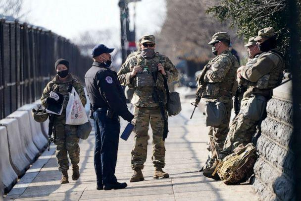 PHOTO: National Guard talk with a U.S. Capitol Police officer outside the Capitol building, March 4, 2021, in Washington, D.C. (Jacquelyn Martin/AP)