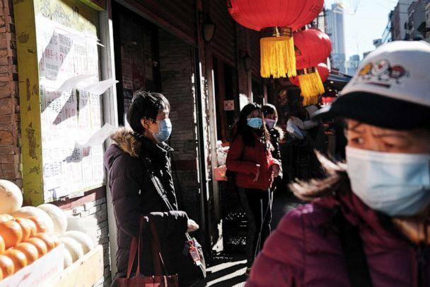 PHOTO: People walk through the streets of Chinatown neighborhood of New York, March 02, 2021. (Spencer Platt/Getty Images)