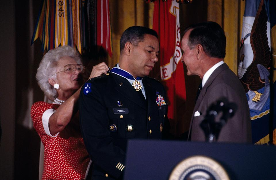 Colin Powell, chairman of the Joint Chiefs of Staff, receives the Presidential Medal of Freedom from President George H.W. Bush and first lady Barbara Bush.
