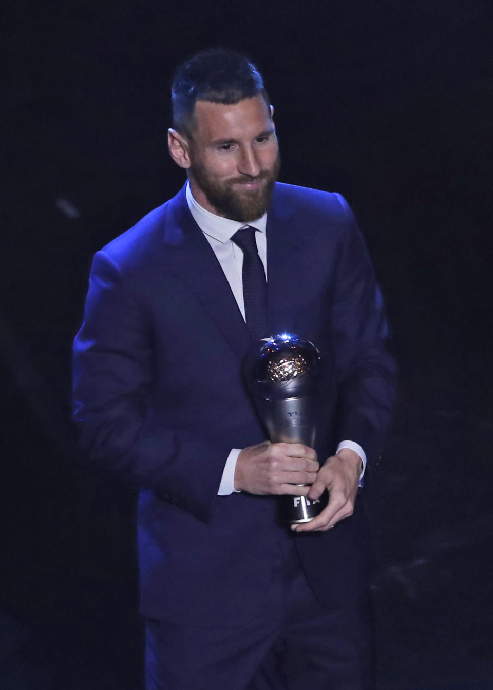 Argentinian Barcelona player Lionel Messi receives the Best FIFA mens player award during the ceremony of the Best FIFA Football Awards, in Milan's La Scala theater, northern Italy, Monday, Sept. 23, 2019. (AP Photo/Antonio Calanni)