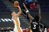 Atlanta Hawks guard Bogdan Bogdanovic (13) shoots over Toronto Raptors forward OG Anunoby (3) during the first half of an NBA basketball game Tuesday, April 13, 2021, in Tampa, Fla. (AP Photo/Chris O'Meara)