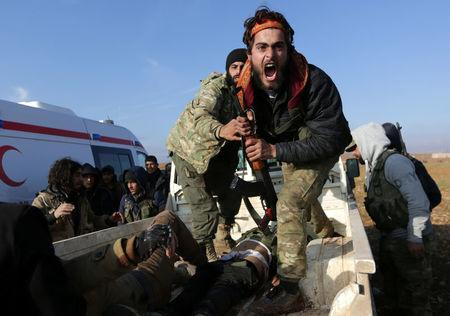 A Free Syrian Army (FSA) fighter reacts as he mourns near the body of his brother, who was an FSA fighter and died during an offensive against Islamic State fighters to take control of Qabasin town, on the outskirts of the northern Syrian town of al-Bab, Syria. REUTERS/Khalil Ashawi