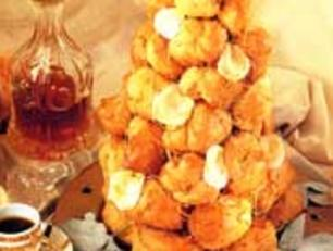 """<p>For dessert impress your guests with a Croquembouche, which is a   traditional French dessert made of profiteroles filled with cream   or creme patisserie. The traditional dish, which literally means   'crunch in the mouth', is stacked into a cone shape and decorated with spun sugar. <a rel=""""nofollow"""" href=""""http://au.food.yahoo.com/recipes/recipe/-/5348519/croquembouche/"""">View recipe</a></p>"""