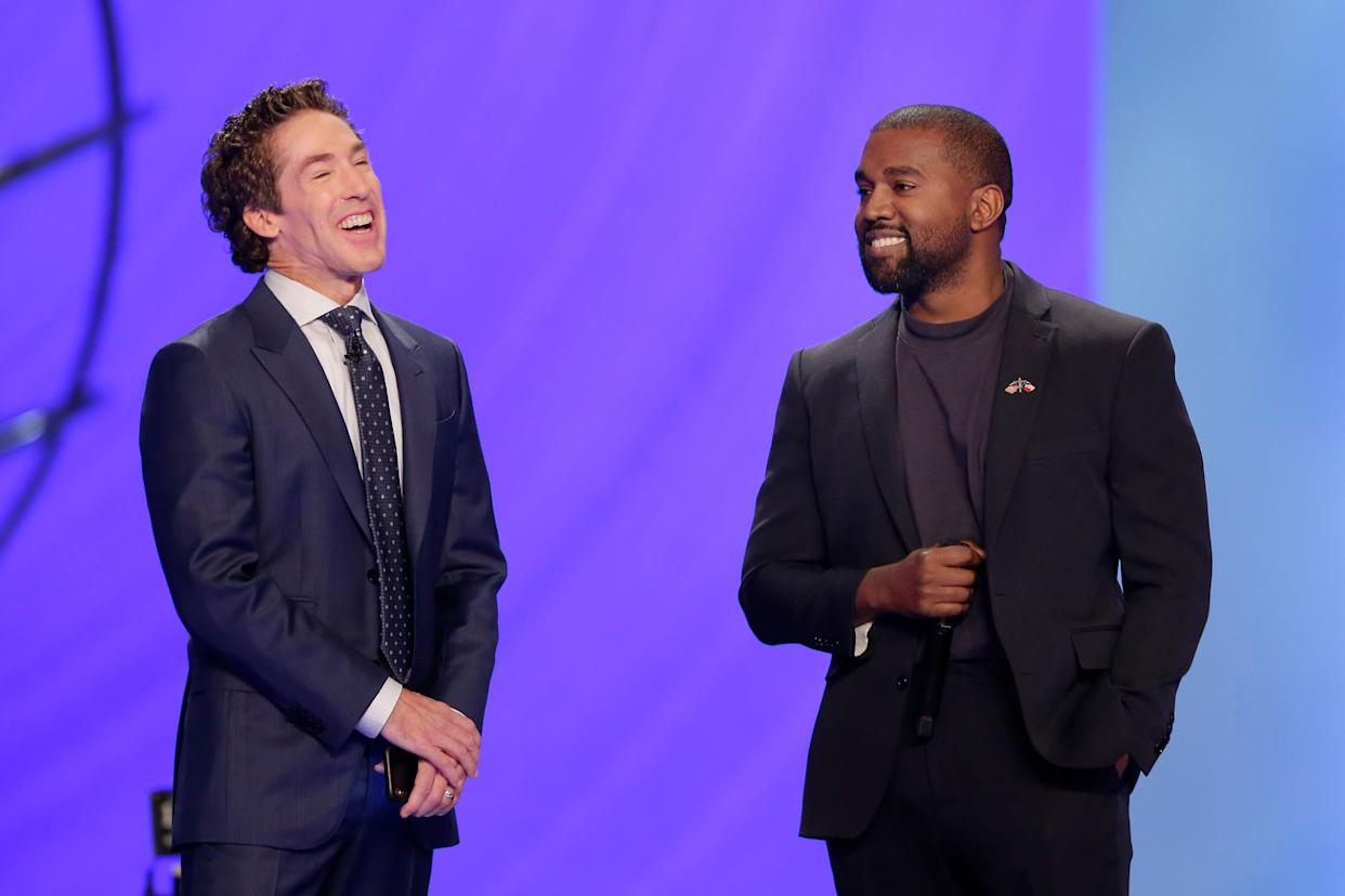 Kanye West, right, answers questions from senior pastor Joel Osteen, left, during a service at Lakewood Church, Sunday, Nov. 17, 2019, in Houston. (Photo: Michael Wyke / ASSOCIATED PRESS)