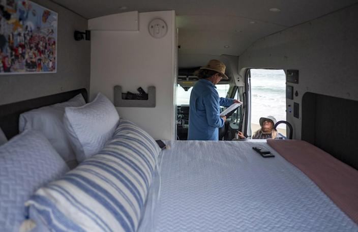 A large bed in the back of a van