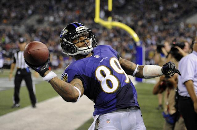 Baltimore Ravens wide receiver Steve Smith throws the ball into the stands after scoring a touchdown in the first half of an NFL preseason football game against the Washington Redskins, Saturday, Aug. 23, 2014, in Baltimore. (AP Photo/Nick Wass)
