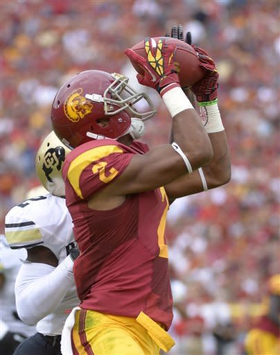 Southern California wide receiver Robert Woods, right, catches a pass for a touchdown as Colorado defensive back Kenneth Crawley defends during the first half of an NCAA college football game, Saturday, Oct. 20, 2012, in Los Angeles. (AP Photo/Mark J. Terrill)