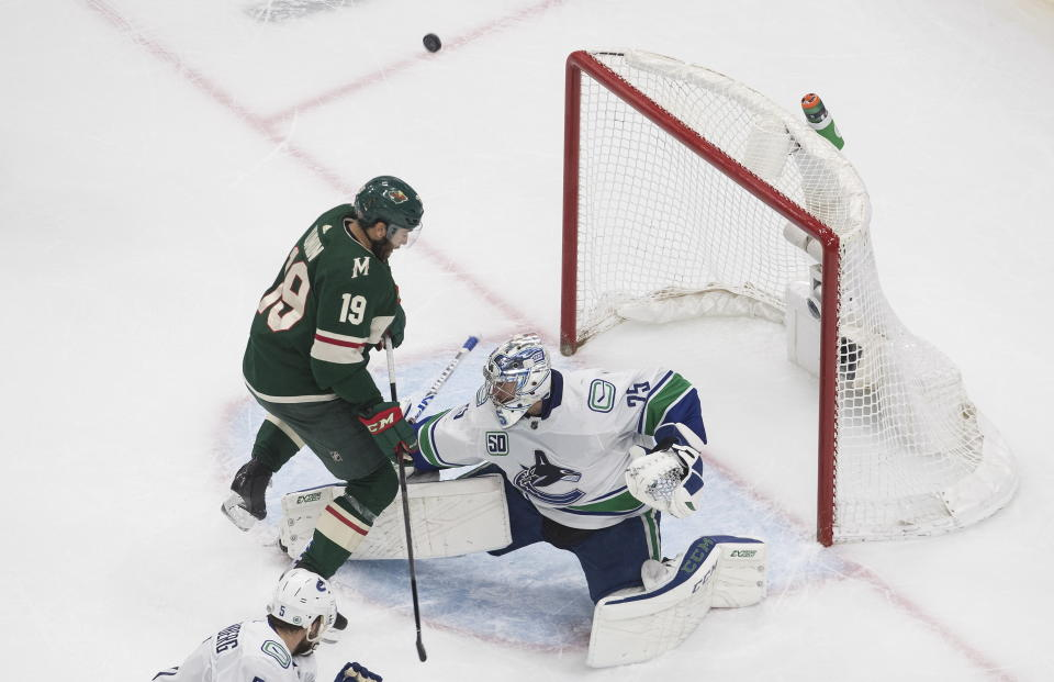 Minnesota Wild's Luke Kunin (19) is stopped by Vancouver Canucks goalie Jacob Markstrom (25) during the second period of an NHL hockey playoff game Thursday, Aug. 6, 2020 in Edmonton, Alberta. (Jason Franson/The Canadian Press via AP)