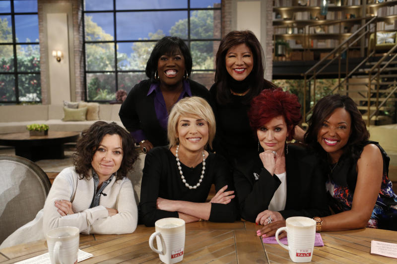 "In this Monday, Jan. 4, 2014 photo released by CBS, actress Sharon Stone, second right, sits down with the hosts, from left, Sara Gilbert, Sheryl Underwood, Sharon Stone, Julie Chen, and Aisha Tyler of ""The Talk."" Tyler is a regular panelist on the CBS' show. She is also the voice of agent Lana Kane on FX animated series, ""Archer,"" the fifth season of which premiered this week. (AP Photo/CBS, Cliff Lipson)"