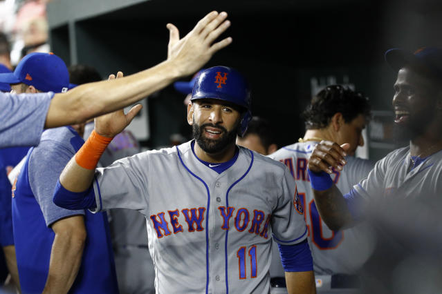 New York Mets' Jose Bautista (11) high-fives teammates in the dugout after scoring on Amed Rosario's single in the fifth inning of a baseball game against the Baltimore Orioles, Tuesday, Aug. 14, 2018, in Baltimore. (AP Photo/Patrick Semansky)
